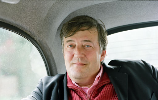 photo of Stephen Fry in a taxi.